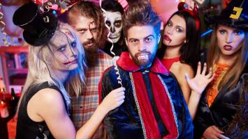 People in costume at Halloween party.