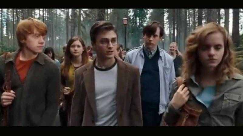 Scene from the Harry Potter series Harry Potter and the Order of the Phoenix showing Harry and his two companions, Ron and Hermione walking away from the famous Hogwarts castle.