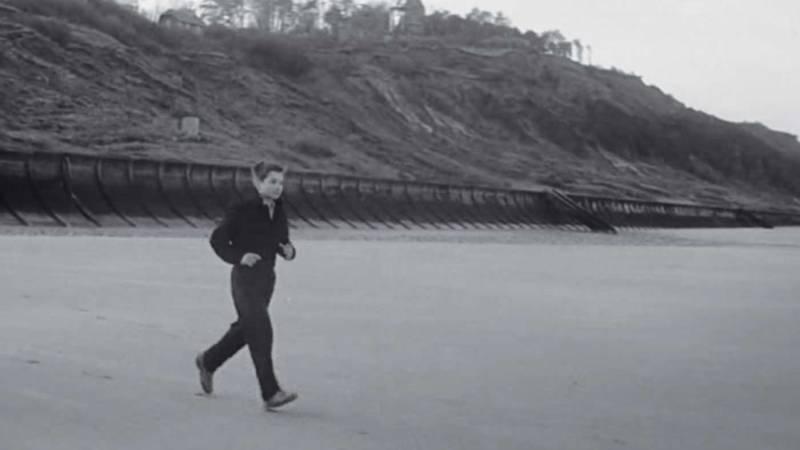 "Scene from ""400 Blows"" of a boy running across a beach."