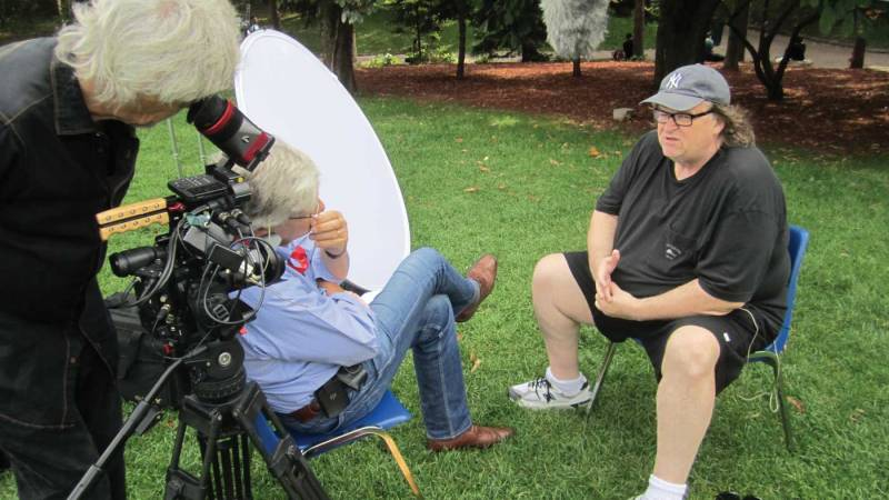 Here, Westheuser  captures Peter Raymont interviewing high-profile adversarial documentary filmmaker Michael Moore.
