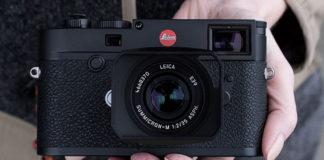 A hand holding a Leica M10