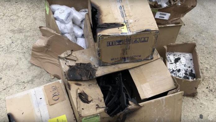 Smoke damaged boxes from SmallHD's warehouse