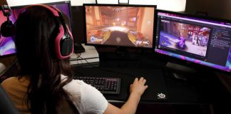 A woman playing a computer game and streaming