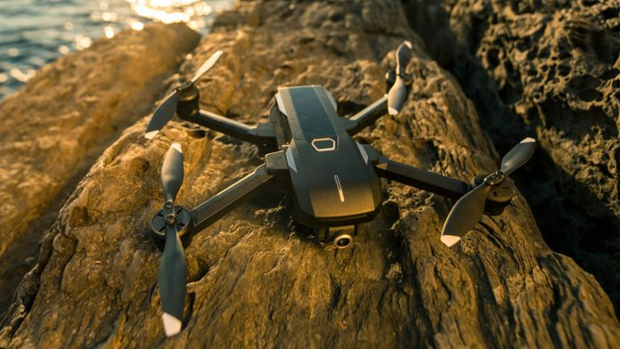 Mantis Q drone on a cliff near water