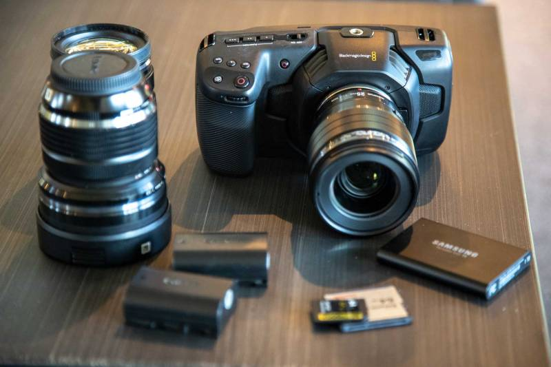 Blackmagic Designs Pocket Cinema 4k camera with Canon EP-L6 batteries, SD, C fast 2.0 and SSD media storage. Also pictured three micro four thirds lenses.