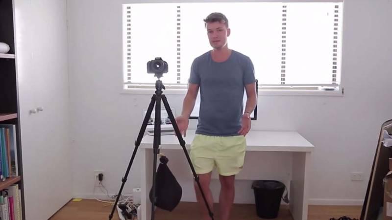 Camera mounted on tripod with sandbag holding it down