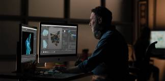 Editor working on an Apple iMac