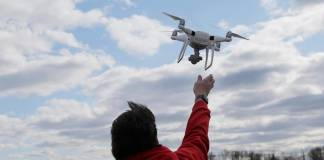 Drone lifting off from operator's hand