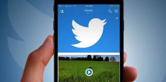 Twitter logo and video displaying on a phone