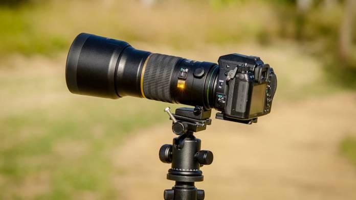 Camera mounted to a tripod