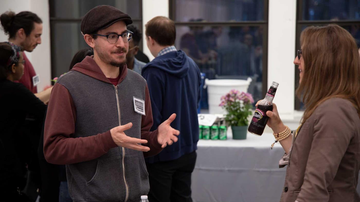 Two creatives talking at Videomaker's IRL meetup event