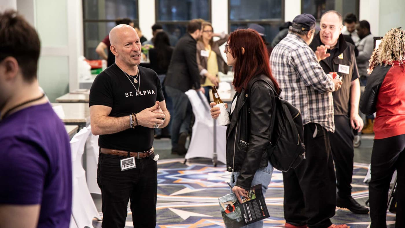 Woman talking to a presenter at Videomaker's IRL meetup event