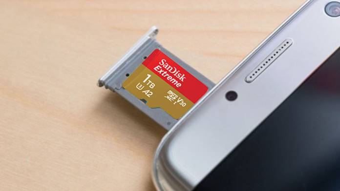 SanDisk Extreme microSD card being inserted into a phone