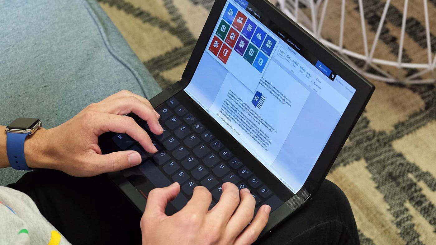 Hands typing on the Lenovo's foldable ThinkPad X1 PC