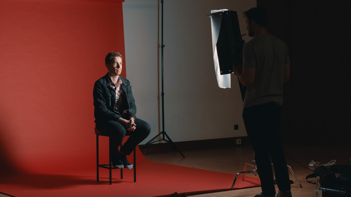 Actor sitting in chair looking at director