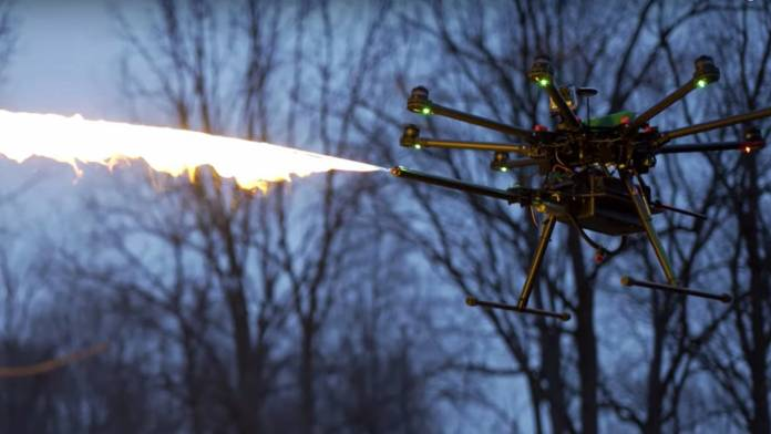 Drone with flamethrower attached to it