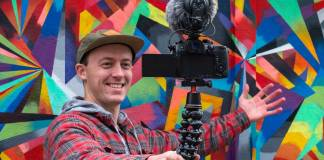 Smiling man with camera mounted on a GorillaPod