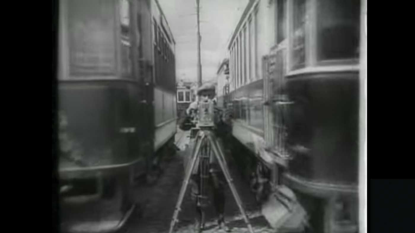 """Scene from """"Man with a Movie Camera"""" (1929) Man standing with a camera."""
