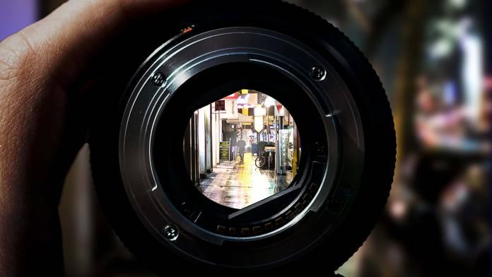 viewing a street scene through a detached lens at maximum aperture