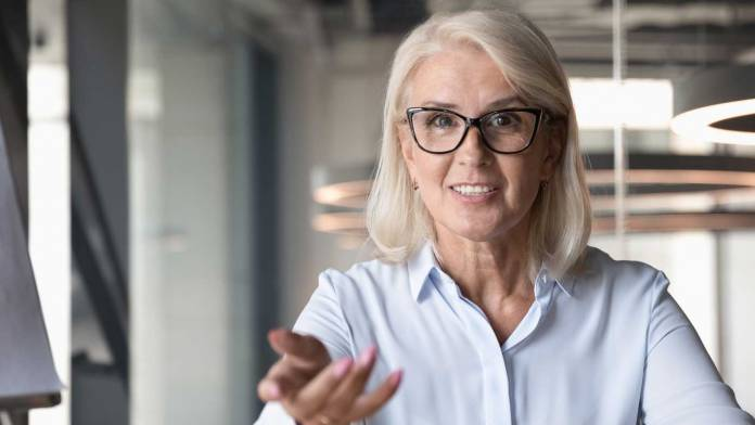 Mature businesswoman looking at camera and talking