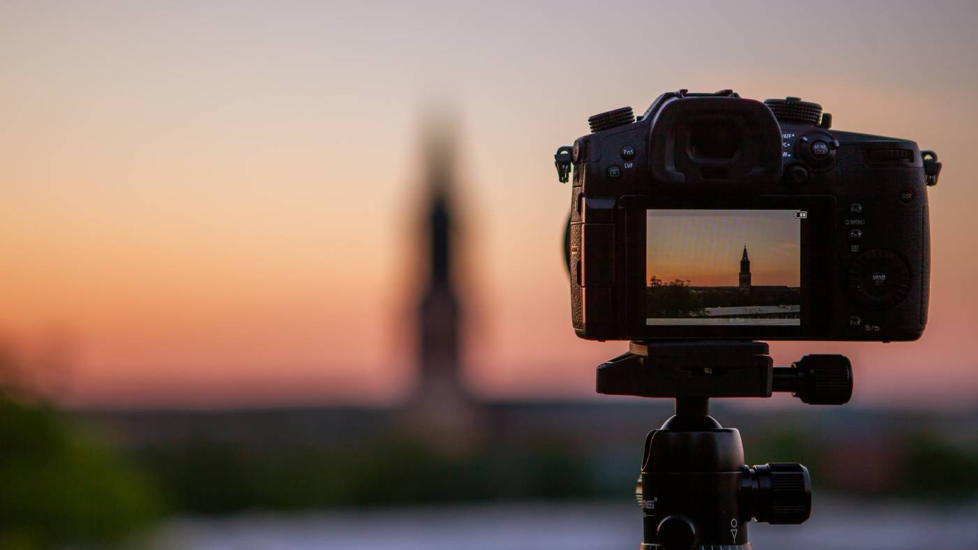 professional video camera shooting sunset