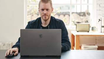 Man using MSI Creator 17 laptop