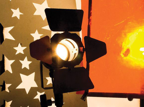 Fresnel light with colored light and stars cut out of paper