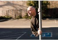 Split Screen: A man appears to be coming right out of a pole