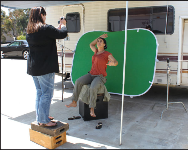 Figure 2: Since the stairs on the background plate were shaded, we shaded our actor when we shot the green screen. We also made our character lean backwards so her hair and earrings would fall in a natural manner.