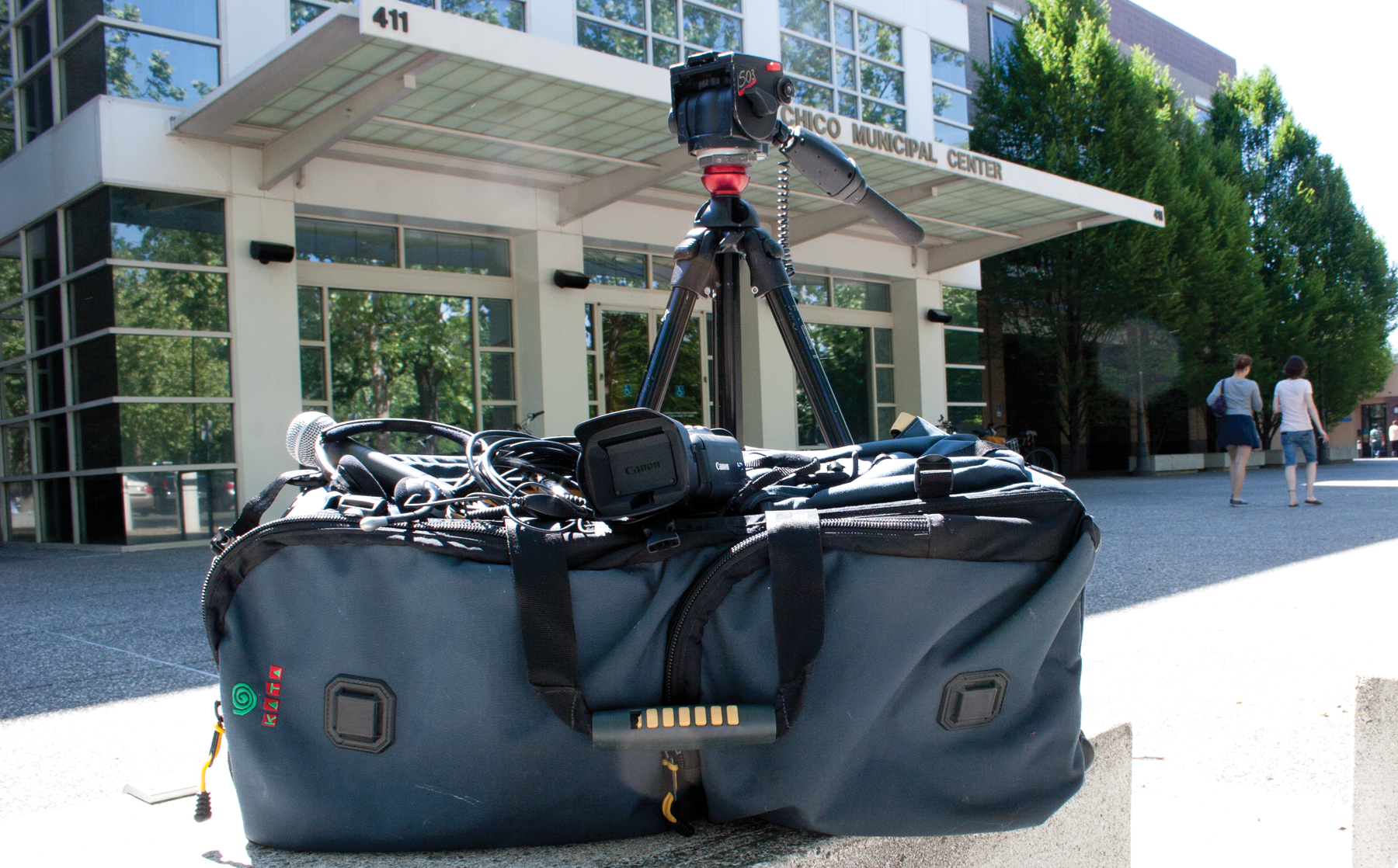 2 photos of gear bag with video gear on location at City Hall and a baseball game