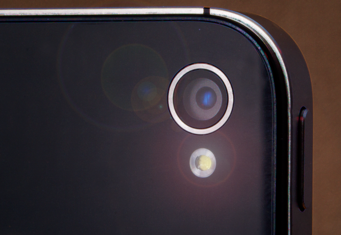 Closeup of the camera lens of a mobile phone