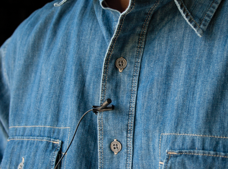 Close up of a microphone on a man's shirt