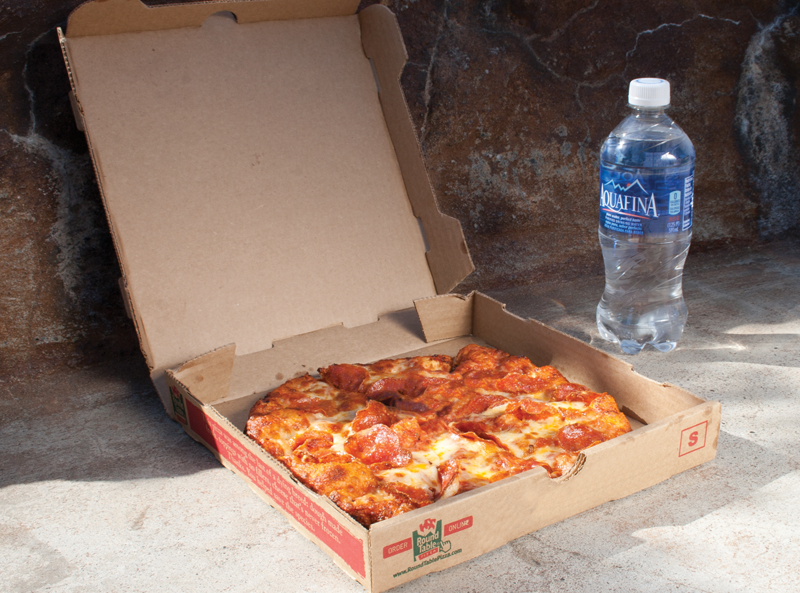 2 shots of a Pizza in a box and water bottle. One shot shows the names and logos of the products, the other shot has them hidden.