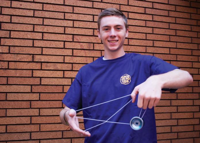 Young man illustrating awesome yo-yo tricks
