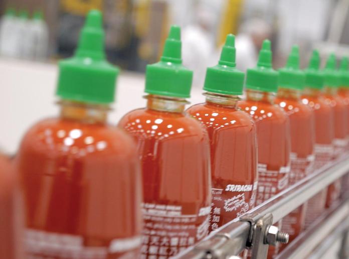 Sriracha bottles in the factory