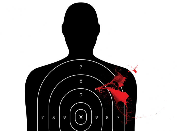 Shooting target with blood squirting out of it.