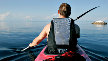 POV shot of a man floating in a kayak