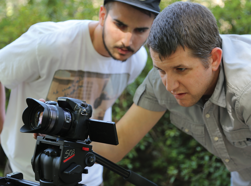 Two Videomaker staffers check out the Panasonic GH4.