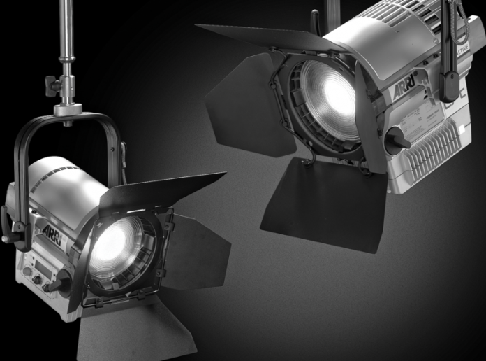 Image of two Arri lights suspended from ceiling grid.
