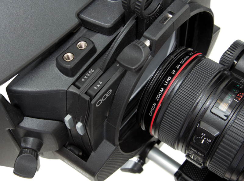 Adjustable toothed gear engages focus ring on lens