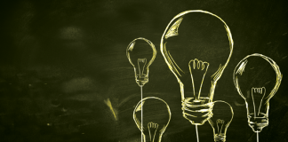 Image of hand drawn light bulbs on a chalkboard