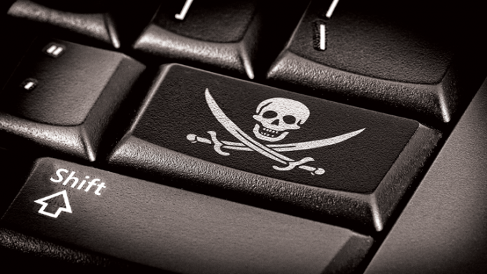 Close up of computer keyboard with skull and crossbones on enter key