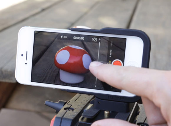 smartphone on a tripod viewing a toy mushroom