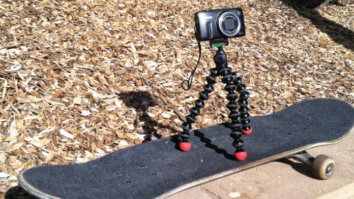 Canon Powershot SX260 HS mounted on a Joby Gorilla Grip mini tripod on a skateboard