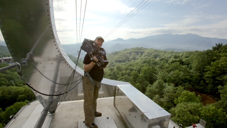 Cinematographer Gavin Thurston riding a cable car in Tennessee.