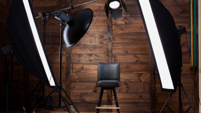 Home studio with pre-set grid or stand lighting and multiple pull-down backdrop options, with tripod, camera and audio already in place