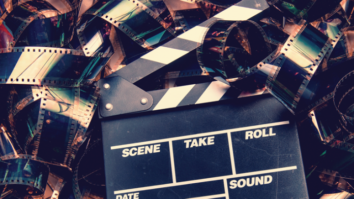 Film strip on floor with clap-board