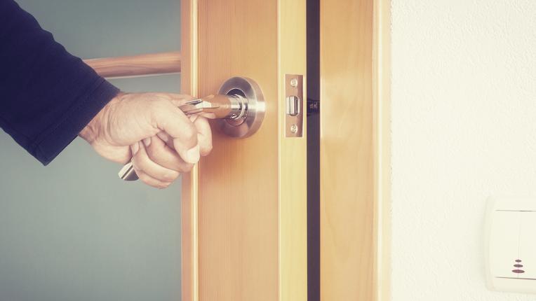Person opening door.