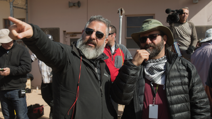 WHISKEY TANGO FOXTROT  Left to right: Director Glenn Ficarra and Cinematographer Xavier Grobet on the   set of Whiskey Tango Foxtrot from Paramount Pictures and Broadway   Video/Little Stranger Productions in theatres March 4, 2016.  Photo credit: Frank Masi  © 2015 PARAMOUNT PICTURES. ALL RIGHTS RESERVED.
