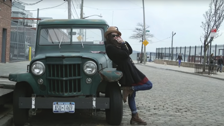 Katharine Marion, playing a harmonica solo at the faded green truck that seemed permanently parked on a cobblestone street.